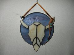 Stained glass cow skull overlaid on circle by NitasStainedGlass