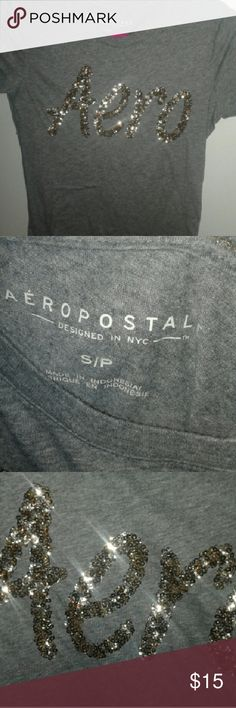 Very gently used gold and grey areopostale shirt Grey shirt with golden letters g and very soft has only been wore ounce Aeropostale Skirts Skirt Sets
