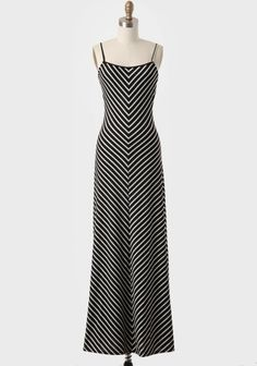 Shopruche.com...A white chevron print adorns this black tank maxi dress featuring adjustable shoulder straps and plenty of stretch for the perfect fit. Pair this lovely dress with sandals in the summer, and wear it with a pullover sweater come fall for a variety of chic ensembles. Partial shelf bra. $47