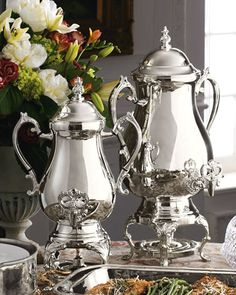 Silver-plated coffee urns are serving essentials. Available in two sizes to suit your crowd. coffee urn is x x urn is x x By Godinger Silver.