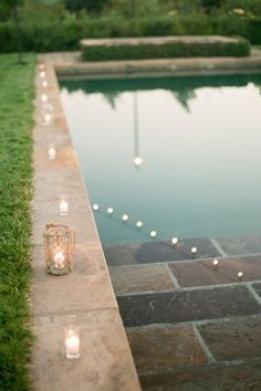If you have a pool on location, place candles around its edge. #Wedding