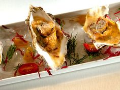 Huur de Oesterkoning in voor uw party www.oesterkoning.nl chilled-oyster-and-sea-urchin-with-yuzu-truffle-vinaigrette