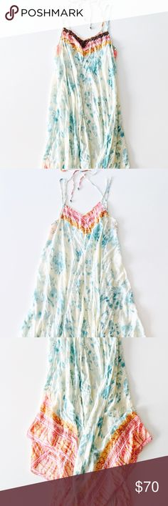"""SOLD Free People Embellished Tie Dye Maxi Dress Style: Lightweight fabric, dyed print, beaded embellishments, adjustable tie straps, asymmetrical hem. Measurements: ≈58"""" length. Fabric: Rayon. Condition: Pre-owned with slight wear and a few loose threads; otherwise good condition. Care: Hand wash cold. Free People Dresses Maxi"""