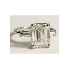 Brides.com: Angelina Jolie's Engagement Ring: Get the Look. Style 17878, platinum ring with tapered baguettes and emerald-cut center stone,  $2,800 (without center stone), Blue Nile See more emerald-cut engagement rings.