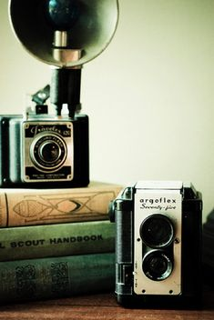 Old books + Old camera's + old postcards = my favorite collectables. good picture