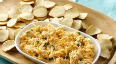 Beer Cheese Spread with Baguette Chips - Swiss cheese, Cheddar cheese, cream cheese, beer, garlic, Worcestershire sauce, & green onions.