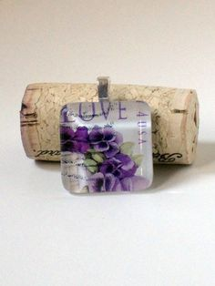 2010 purple pansy US love postage stamp set in glass tile pendant.
