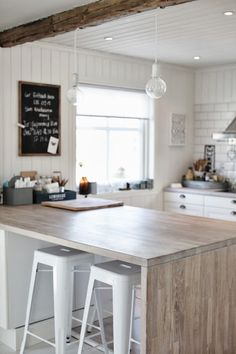 Coastal kitchen idea, modern beachy kitchen. Love the contrast of wood on white. Simple and comfortable.