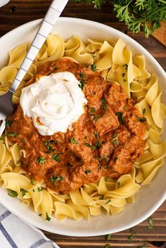 This easy Hungarian goulash is the ultimate stick-to-your-bones comfort food. Beef chuck simmered with onions and tomatoes until tender and mixed with sour cream for an ultra-creamy and rich stew you can serve over noodles, potatoes, or spaetzle.