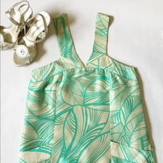 """Cynthia Vincent tropical print dress Dress by Twelfth Street by Cynthia Vincent will power you through the summer wedding season. Tropical print in seafoam green which pops off the ivory/beige background, pockets, slight bubble hem, flattering neckline, 100% silk shimmers slightly. 33.5"""" long; 16.5"""" across chest lying flat; size zip; fully lined. 100% silk- what may appear as snags in fabric are just the natural silk fibers. Purchased at Barneys. No tears, stains or pilling – lightly used, just dry cleaned, great condition! Twelfth Street by Cynthia Vincent Dresses"""