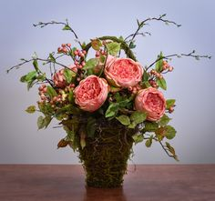Gorgeous large peach cabbage roses, berries and greenery in a moss covered basket. A perfect year round accent to your home or as a gift! Features - 14 in x 14 in x 19 in - Made-to-Order In Powell Ohi Rosen Arrangements, Basket Flower Arrangements, Silk Floral Arrangements, Beautiful Flower Arrangements, Wedding Flower Arrangements, Floral Centerpieces, Floral Bouquets, Beautiful Flowers, Centrepieces