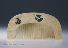 Japanese comb of carved elephant ivory with an inlay of a shakudo bird, ca 1900. This hair ornament is beautifully designed and crafted with a low relief of clouds and willows, and a shakudo starling flying above the tines.