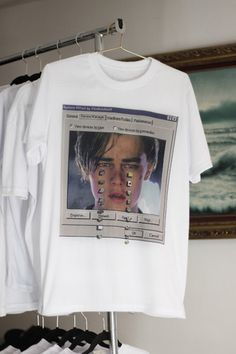 t-shirt leonardo dicaprio computer white shirt graphic tee white t-shirt leonardo di caprio printed t-shirt top grey tank top starbucks coffee logo funny shirt funny nerd tumblr white cyber rad ghetto cool fashion style attire fab fav aesthetic pinterest print tumblr shirt celebrity grunge soft grunge titanic white dress grunge t-shirt quote on it indie windows? 90s alternative pale box romeo and juliet