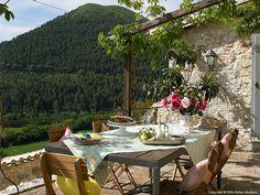 Outdoor dining at Casa della Roccia in the stone hamlet called Borgo Pianciano near Spoleto.
