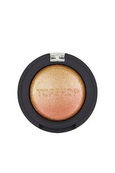 We discovered this two-tone chrome highlighter last year — and it's quickly become one of our favorites. In certain lights, the shimmery powder has a rosy, peachy sheen, and in others it veers more gold.Topshop Chameleon Glow in Shuffle The Cards, $13, available at Topshop. #refinery29 http://www.refinery29.com/affordable-highlighter-makeup#slide-1