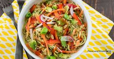 This Asian Zoodle Buddah Bowl is packed with fresh veggies and topped with a vegan peanut sauce. Low fat, gluten free and ready in 10 minutes. An easy weeknight dish that doesn't require any cooking and kids will gobble up!   www.pancakewarriors.com