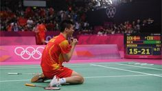 Haifeng Fu of China celebrates winning his Men's Doubles Badminton Gold Medal match against Mathias Boe and Carsten Mogensen of on Day 9