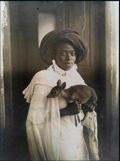 Young Kenyan women holding a Dik-Dik, Mombasa 1909 (455x607) : HistoryPorn