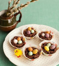 Easter Nests ~ melted chocolate candy with butter, syrup, & Shredded Wheat to make bird nests for decorating | by Miranda Gore-Browne from her cookbook 'Biscuit' | via The Happy Foodie