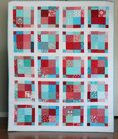 Red and Aqua Throw Quilt - via Etsy.  variation of the disappearing nine-patch quilt pattern.