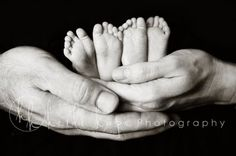 twin feet--one mama hand and one daddy hand