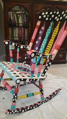 My new rocking chair that my grandma hand painted for me! Painted Teacher Chair, Teacher Chairs, Painted Rocking Chairs, Hand Painted Chairs, Diy Kids Furniture, Funky Painted Furniture, Rocking Chair Makeover, Rocking Chair Nursery, Farmhouse Dining Chairs