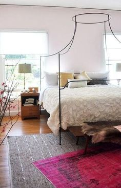 25 gorgeous bedroom decorating ideas - wire canopy bed, layered area rugs, + mid century modern wood bench with fur throw
