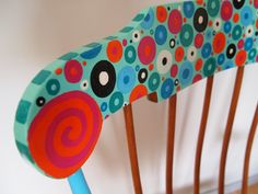 "detail of the rocking chair ""saucy granny"", headrest with magenta and orange swirl: by Rebecca Waring-Crane"