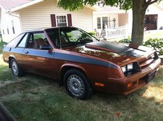 1984 Dodge Charger...my first car. It was black with maroon interior and had louvres in the back window!