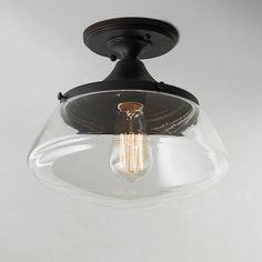 """A modern adaptation on nostalgic diner style lighting, this ceiling light has clean lines and clear glass for timeless appeal. Available in Polished Nickel and Bronze. Rated for dry locations.75W max medium base socket. (9.25""""H x 10.375""""W)Canopy: 5"""" diameter"""
