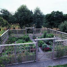 "Deer-proof vegetable garden - The design of the 10-foot-tall fence is adapted from a pattern the owner saw in a past issue of Sunset. Along the bottom of the fence, closely spaced pickets keep out small animals. A grid of squares made of 1-by-1s forms a deerproof barrier above the pickets. The fence is capped by 2-by-8s and beveled 2-by-6s. Here's one way to avoid paying the ""critter tax""!"