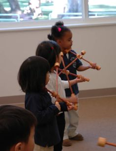my kindergarteners do this naturally when I give them rhythm sticks.
