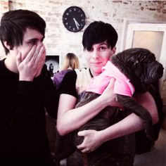 Dan looks like he cant comprehend how cute the dog is and phil just looks adorable :3
