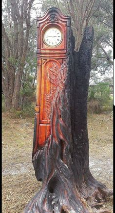 Grandfather Clock carved from burnt tree trunk. Tree Carving, Wood Carving Art, Wood Art, Wood Carvings, Chainsaw Carvings, Driftwood Sculpture, Tree Sculpture, Sculptures, Woodworking Furniture Plans