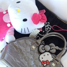 """Hello Kitty Grey Embossed Handbag NWT Hello Kitty addicts here's an authentic HK glossy grey embossed handbag from Loungefly. Has black lining, a zipper compartment & two small pocket compartments. A cute grey bow & hello kitty tags are attached to handle. Also includes original dust bag. It's super spacious! Size: 14"""" x 11"""" x 6"""" 2lbs, 8oz. Pristine condition, never used! Price Firm (Retails for $110). No Trades or Paypal. Bundles encouraged! Loungefly Bags"""