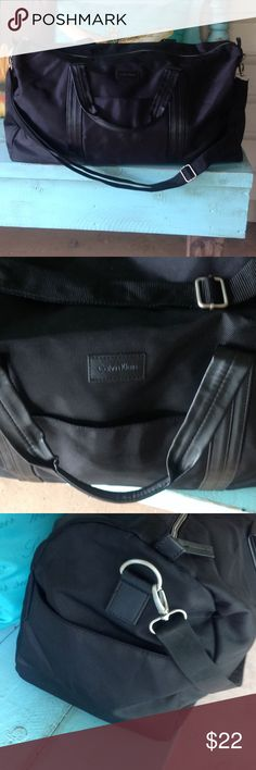 Calvin Klein duffle bag. Calvin Klein duffle bag,never used,super roomy. Measures 21 inches long, 11 inches tall. Bags