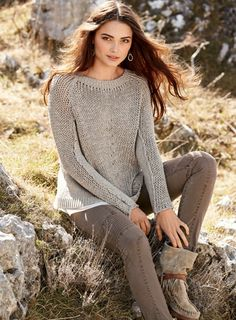Dimensional seaming and a textural mix of open and mid-gauge stitches give this drapy pull over its handmade appeal. Full-fashion knit of heathery Taupe pima yarns, with saddle shoulders and ribbed trim.