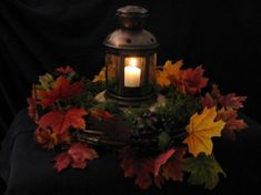 Wedding centerpiece with fall leaves and candles Things I must