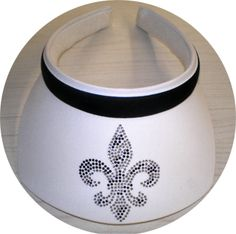Bling is the thing. Be a star with this Fleur de Lis rhinestone embellished Clip On square brim visor with a black band. - One size fits most. - Washable & packable. - Proudly made in the USA. On special reg 36 Now Just $24.00 Get it while they last. http://taketwovisorshop.com/
