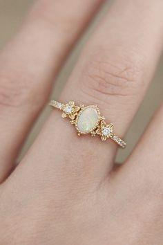 Check this rose engagement ring set. This white gold ring features a round cut pink moissanite beautifully set in a solid rose gold flower setting. A matching diamond wedding ring completes the sentiment. White Opal Ring, Yellow Gold Rings, White Gold, Rose Gold, Solid Gold, Wedding Rings Simple, Unique Rings, Delicate Rings, Gold Engagement Rings