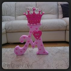 Hand painted wooden initials can be painted in any colours and can have any design painted on or covered in a theme, these are available to order with or without a crown on the top. each letter can have a wooden name tag added, they are also finished with embellishments to match. Designs can include, Frozen Elsa & Anna, Minions, Mickey & Minnie Mouse Etc Each initial is £10 plus postage or £11.50 with a crown. https://www.facebook.com/TheCraftyOwl46?fref=photo