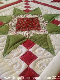 THE QUILTED PINEAPPLE: Christmas Stars. Check out the way she quilted the squares to make them look like cathedral windows. Machine Quilting Patterns, Quilt Patterns, Star Quilts, Quilt Blocks, 24 Blocks, Scrappy Quilts, Handi Quilter, Pineapple Quilt, Free Motion Quilting