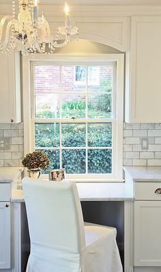 Style at Home: Effie Genovese - Elegant office nook within kitchen. Creamy white built-in desk, carrara ...
