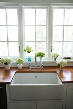 Farmhouse Apron Front Sink / Really love this type of sink for its simplicity and utility, as well as the way it makes the sink more of a visual feature than it usually does, taking advantage of what is often under-used space. I like both ceramic and stainless steel.