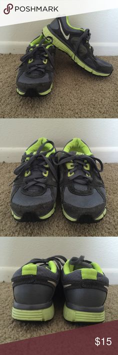 Nike Dual Fusion ST 2 Athletic Shoes A pair of athletic shoes by Nike in a size 7. It is black and neon yellow in color. They have been worn a handful of times and are in good condition.   Thank you for visiting my closet! I consider offers and I do not trade. Nike Shoes Athletic Shoes