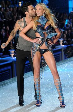 adam levine and victoria secret model. I don't know who that whore thinks she is.. letting my man kiss up on her!!!