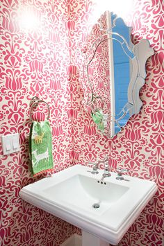 Wallpaper and mirror, half bathroom. Like the wallpaper. I wonder if it comes in blue or Kelly green?