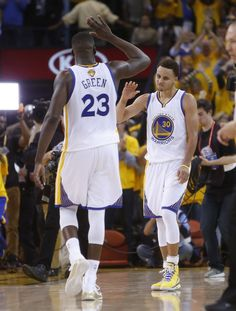 Golden State Warriors' Stephen Curry and Draymond Green high five at end of Warriors' 108-100 win over Cleveland Cavaliers in Game 1 of the 2015 NBA Finals at Oracle Arena in Oakland, Calif., on Thursday, June 4, 2015. Photo: Scott Strazzante, The Chronicle
