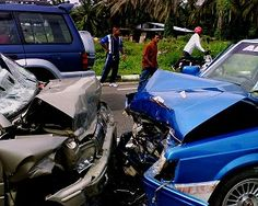 A head-on collision involving two cars.