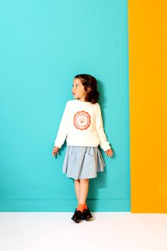 Little Fashion Gallery Sweat College on a strong blue and orange background